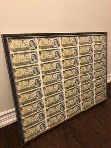 Uncut sheet of Canadian $1 bill with frame