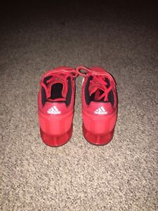Red adidas gym shoes