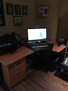 Office desk, filing cabinet and cupboard.