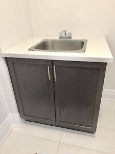 Laundry sink with espresso oak cabinet