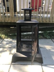 Enclosed outdoor fire pit