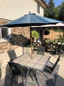 Patio table, chairs & umbrella.