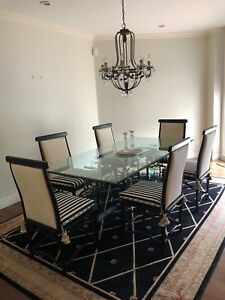 Dining table, chairs, bar stools, carpet, chandelier