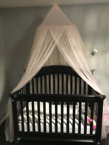 Dark Espresso solid wooden crib. Convertible to toddler bed
