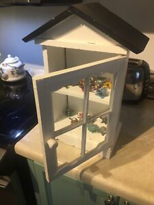 Display cabinet with bobble head animals