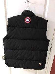 Never worn! Canada Goose large down vest...