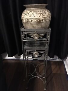 Decorative iron table with pottery