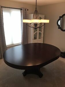 Large round solid wood dining table with leaf