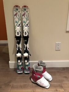 Child's downhill skis and boots