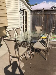 Glass table with metal frame and 6 fabric chairs