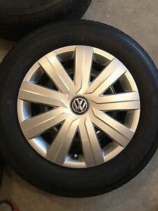 Bridgestone tires with steal rims and VW hub caps 2017