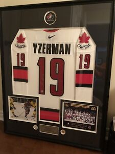 Authentic and signed framed hockey sweater