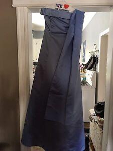 Size 3 gown, worn once and dry cleaned!