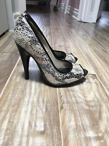 Beige and black Snakeskin heels!