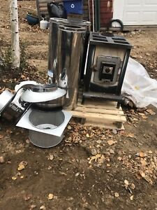 Woodstove and 7inch pipe for sale.