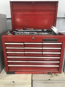 Tool box included with a variety of tools