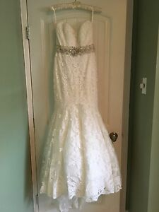 Beautiful ivory lace strapless wedding dress