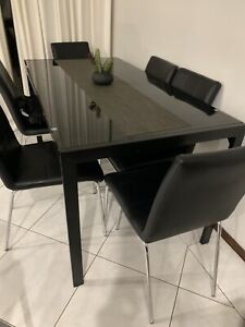 Tempered glass black dining table & chairs