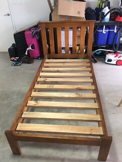 Wooden single bed