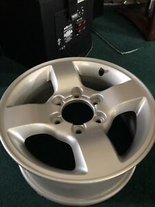16x7 offset 40 6 bolt Nissan Rims