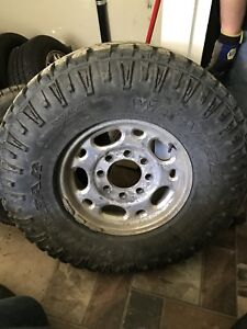 285/75r16 Good Year Wrangler Duratracs and GMC Rims