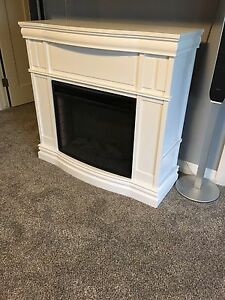 Brand new fireplace still in box.