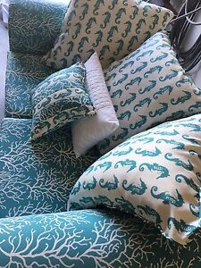 Beautiful seahorse and coral love-seat with 5 accent pillows!