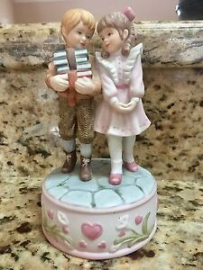 Treasured moments collectors walking home musical figurine