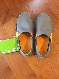 Brand new Crocs sneakers for toddlers size 12
