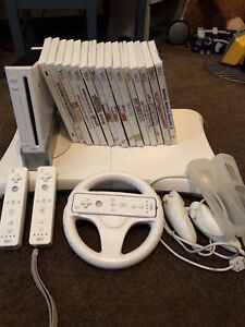 Nintendo Wii with Fit Board and Games
