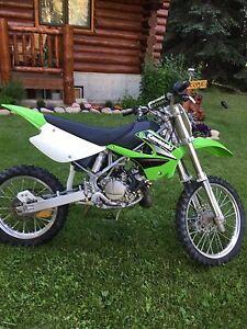 2003 KX 100