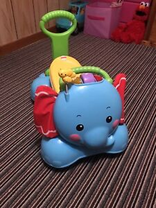 Elephant walker/ride on, exersaucer & jolly jumper