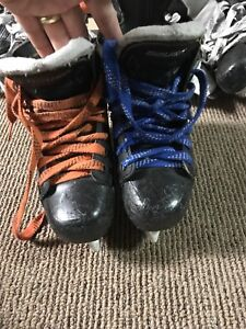 Assorted kids hockey skates and Burl barracuda hockey pants etc