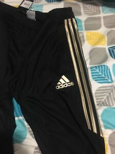 Gold limited edition adidas pants size small