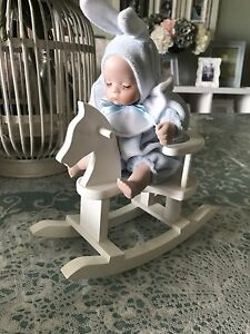 COLLECTIBLE BABY ON ROCKING HORSE