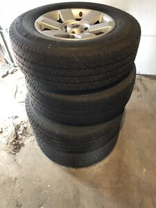 "18"" Nissan rims and tires 265/70/18"