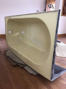 Vintage pastel yellow cast tub