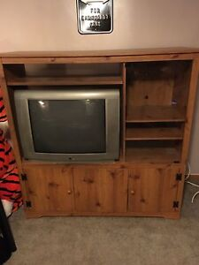 "RCA 32"" TV and stand."