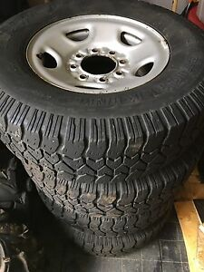 8 bolt rims with tires.