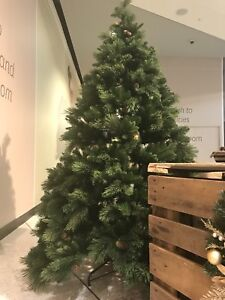 2.1m and 2.4m Christmas trees in snowing white and traditional green