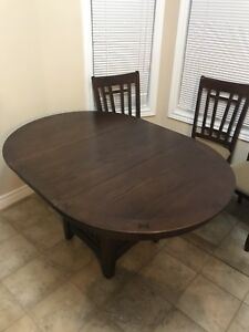 "Brown dark dining table 42"" round extendable to 42""x60"""