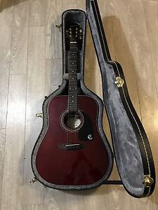 Red Epiphone Guitar, Case, Capo, and Pick