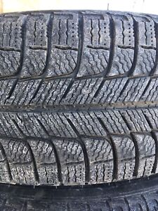 Set of 4 Michelin x-ice rims and tires