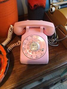 Pink retro rotary phone telephone