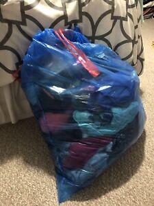 Garbage bag full of women's clothing