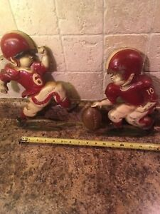 Cast-iron football players