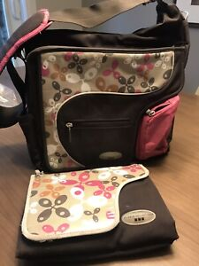 Diaper bag with a changing mat