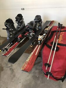 Two sets of downhill skis