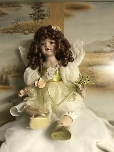 Angel Doll c/w wand,mat and wings.