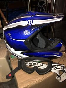 Youth Large ATV helmet with goggles. Both in mint condition